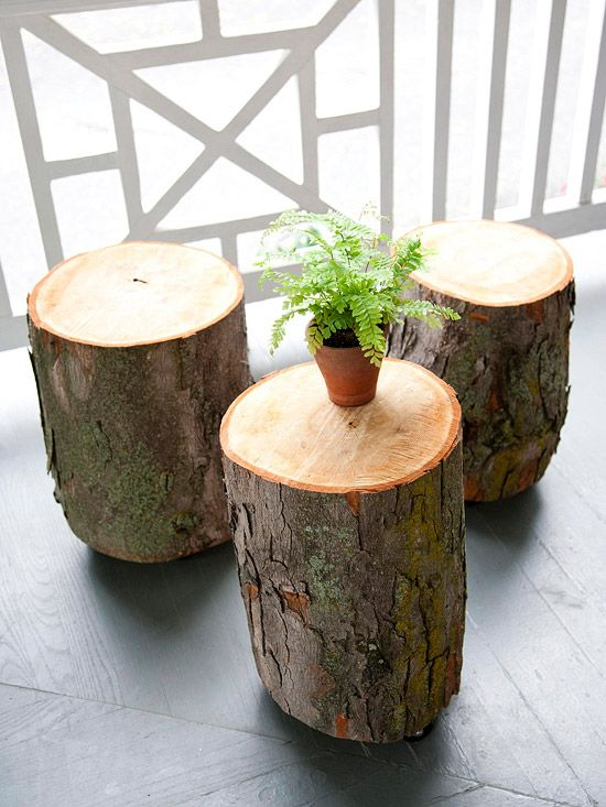 Tree trunks with casters for outdoor tables.  Like.