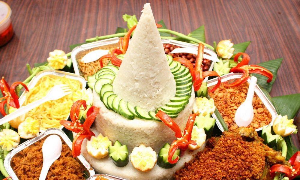 Tumpeng is how the presentation of rice and side dishes in for Authentic indonesian cuisine