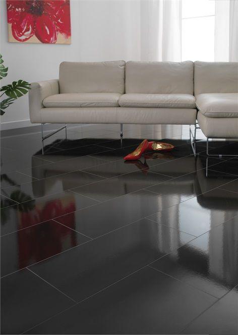 Glossy Black Tiles On The Floor Of A Modern Living Room Black