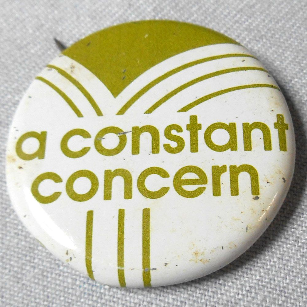 VINTAGE 70s Constant Concern Button Lapel Pinback Medical Advertising Slogan AD