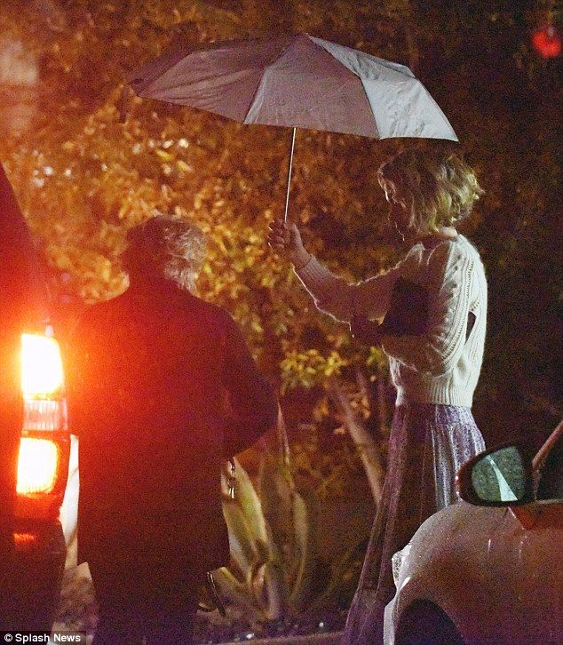 Sarah Paulson holds umbrella for rumoured girlfriend