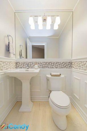 traditional powder room with custom mirrors, hardwood