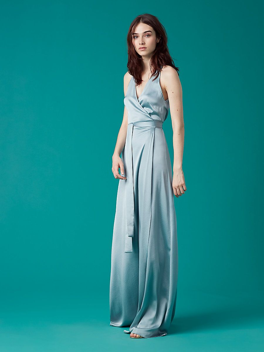 04577a4fab05 A wrap style with a soft satin finish, this elegant and simple floor-length  dress is cut in a brilliant hue and is designed with a halter neck.
