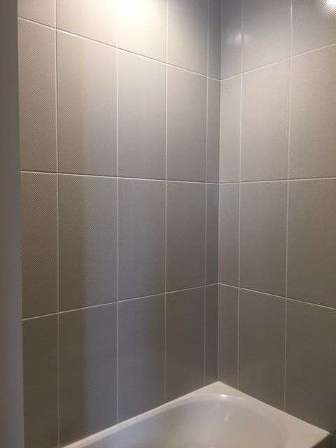 sleek gray vertical stacked wall tile daltile showscape 12x24 wall tile shower design - Shower Wall Tile Design