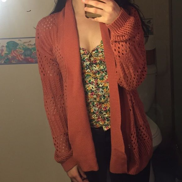Orange sweater This sweater had gotten me lot of compliments! Great for layering! Put free people for exposure! Great condition Free People Sweaters Shrugs & Ponchos