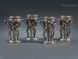 AN OUTSTANDING SET OF FOUR SILVER WILLIAM IV FIGURAL SALT CELLARS BY PAUL STORR - LONDON 1832