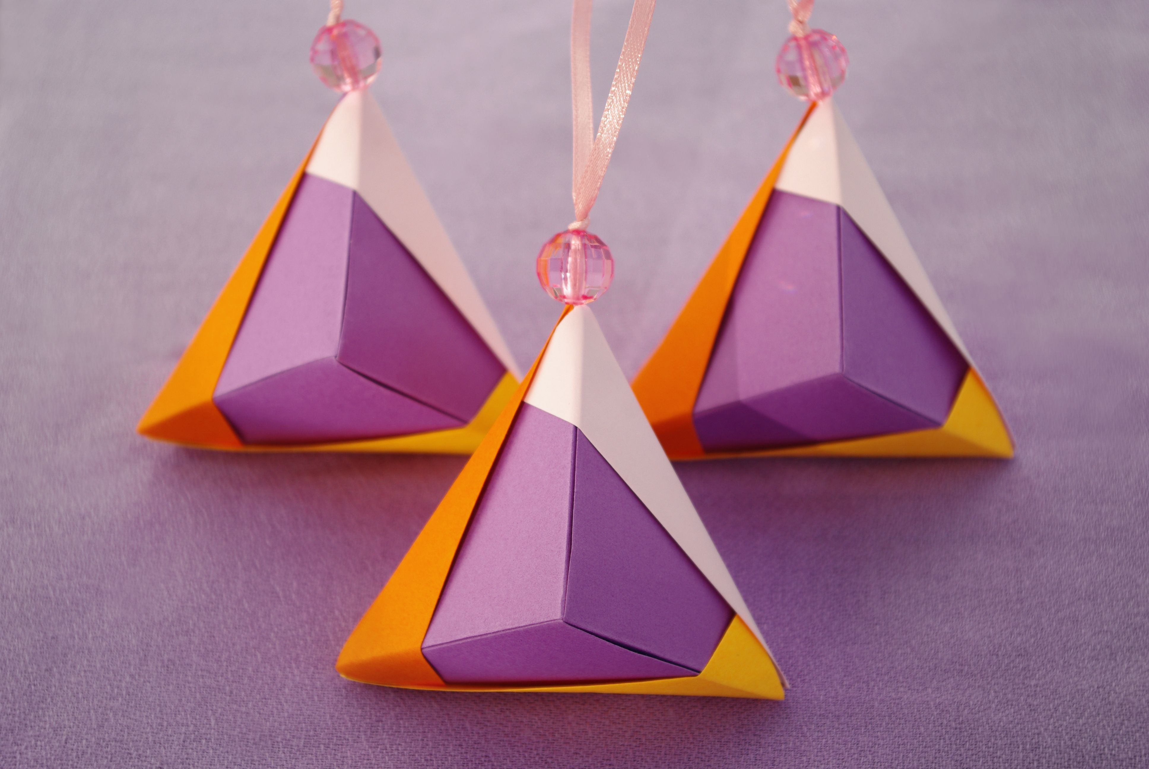 Set of 3 Christmas ornaments.  Purple Origami pyramids by WaveofLight on Etsy, $15.00  https://www.etsy.com/listing/167570548/set-3-christmas-ornaments-purple-origami