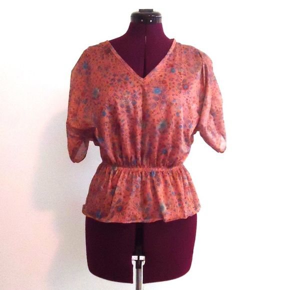 """Vintage 70s Peplum Top Blouse Dolman Sleeves S, M Adorable 70s sheer peplum top with dolman sleeves and an elastic waist.  It is made of polyester and has a cute   Material: polyester Color/print: taupe/brown Maker: unknown Era:  70's Size: S M    Measurements:  Bust- 30""""-38"""" Waist-  22"""" to 30"""" Length- 22"""" Vintage Tops Blouses"""