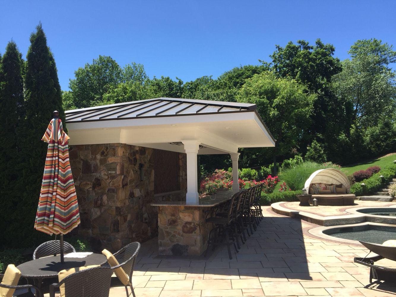 Campbell Exteriors LLC Pool bar Azek trim with standing seam metal roof