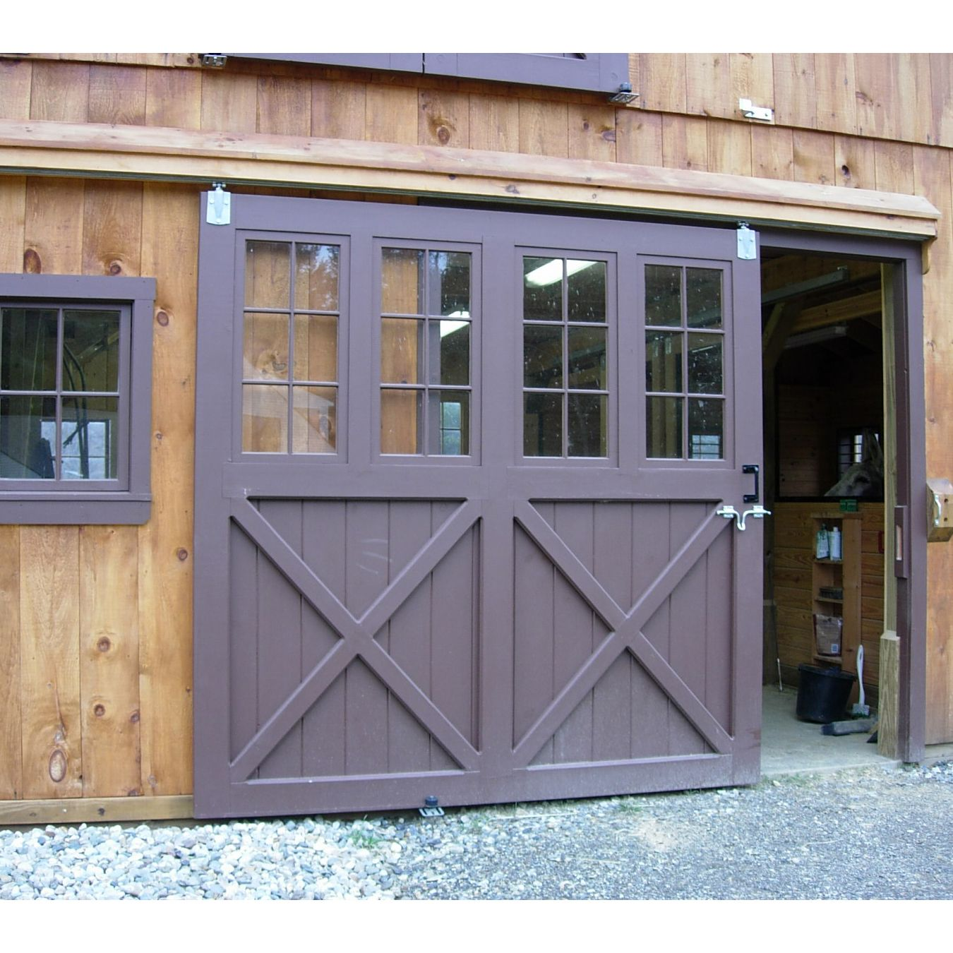 Workshop doors welding workshop with living quarters for Single sliding barn door