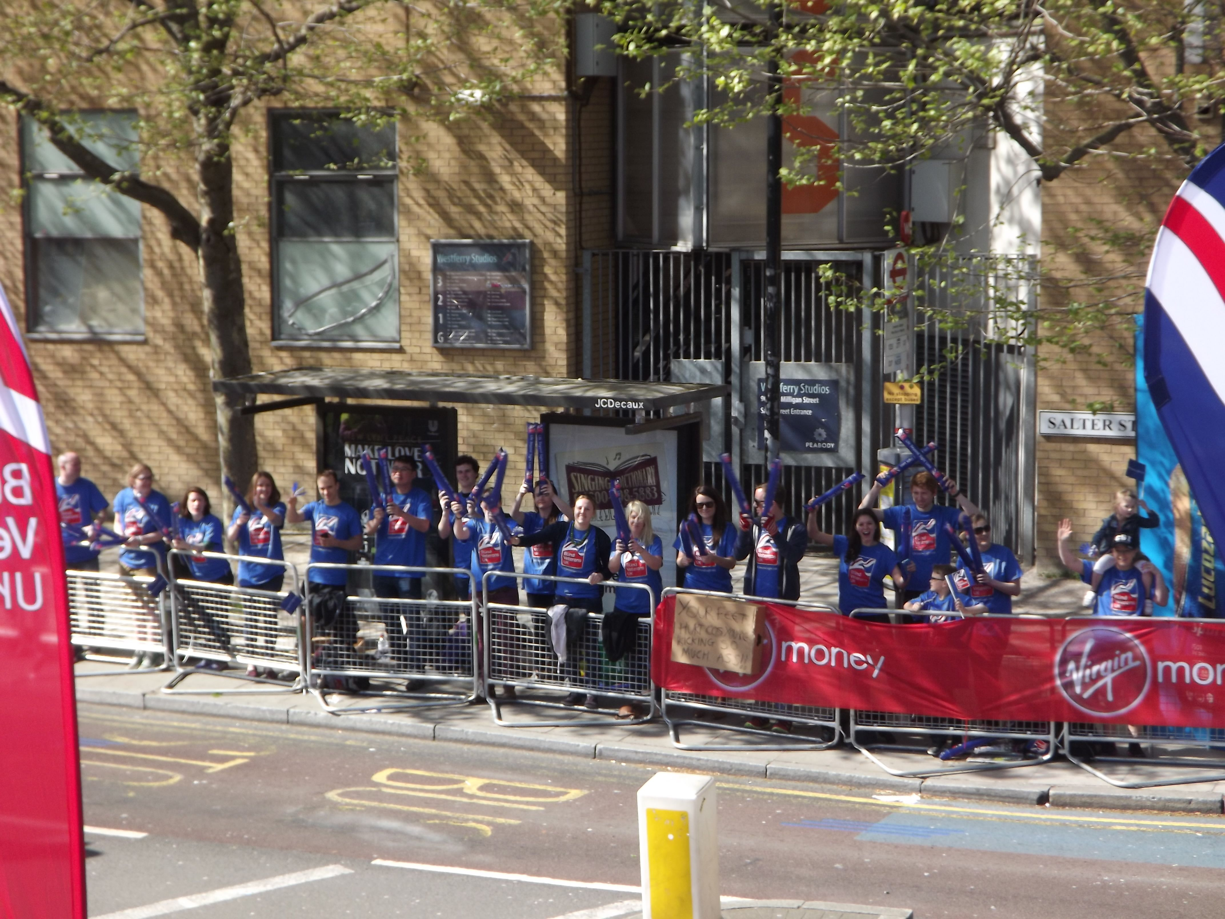 Blind Veterans UK's cheering squad ready to give the runners lot's of encouragement! Thank you to all of you for your amazing support and a big thank you to our volunteers who came to support blind veterans every step of the way. #LondonMarathon  Image credited to Ian Dunn Design