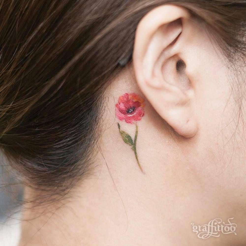 Tiny poppy tattoo behind the right ear watercolor tattoos tiny poppy tattoo behind the right ear izmirmasajfo