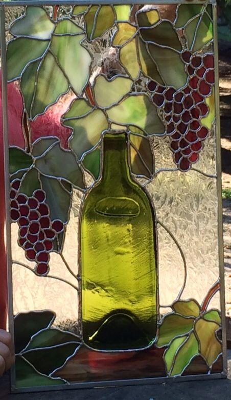 Stained glass with real wine bottle \
