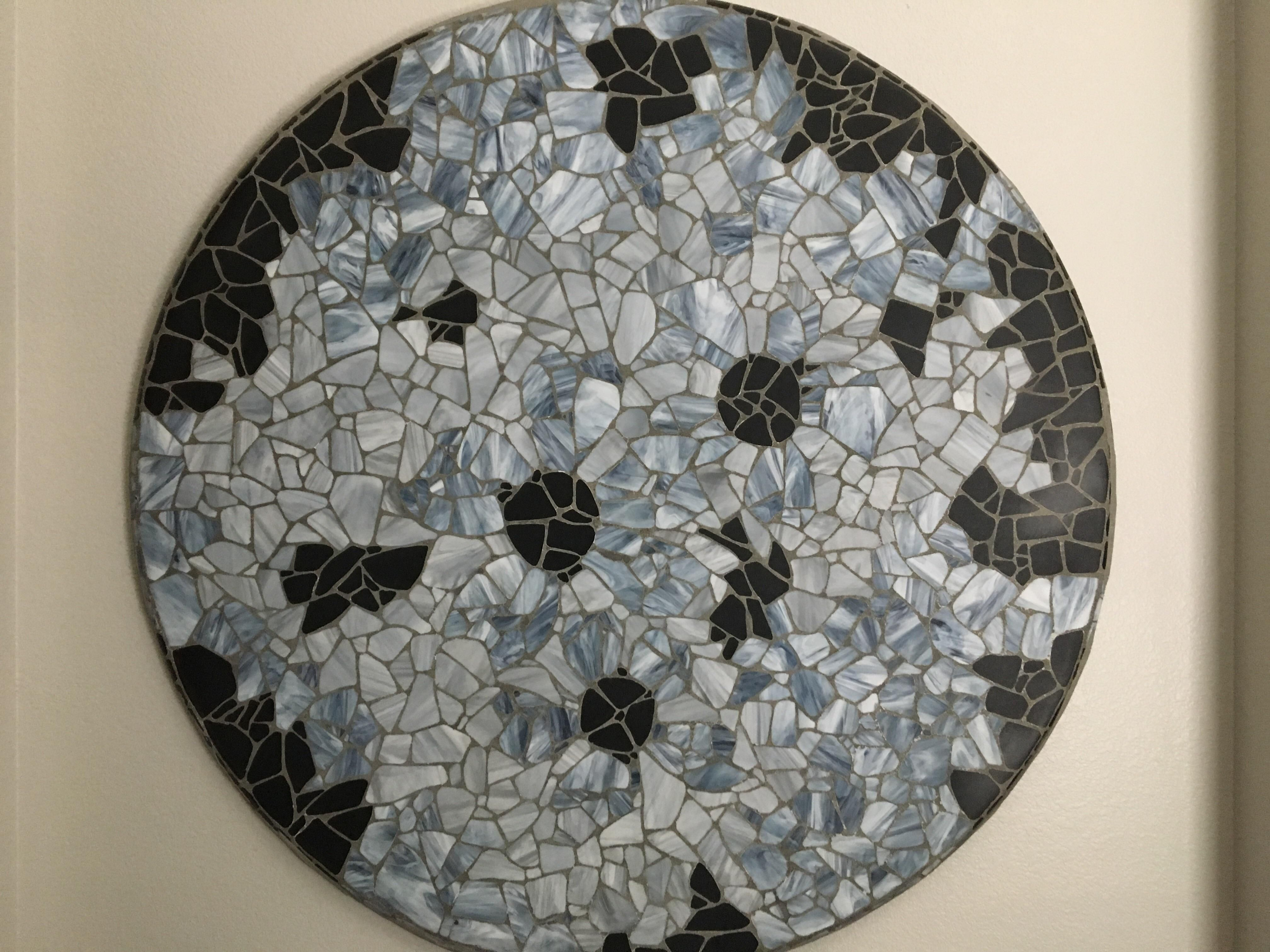 foot diameter glass mosaic made from scrapped glass set in