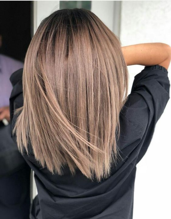 6 Fall Hair Trends We're Stealing from Pinterest, Stat | Every cool girl needs a cool-toned color option, and this muted mocha color is packing major personality with a metallic ash finish. #beautytips #southernliving #hair #hairstyle #hairmediumshort