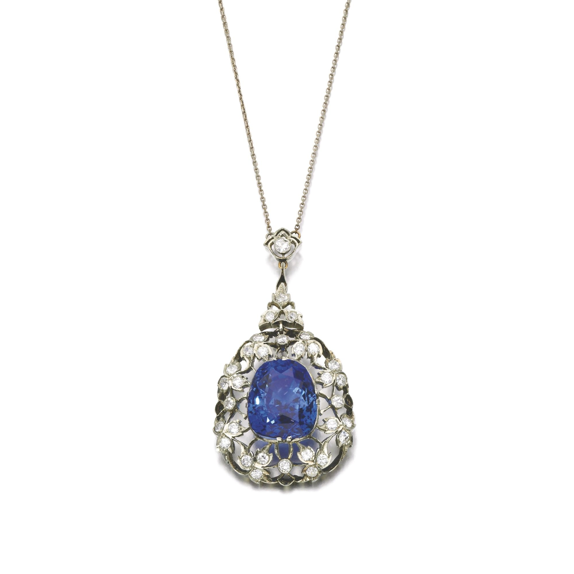 Sapphire and diamond pendent necklace circa clawset with a