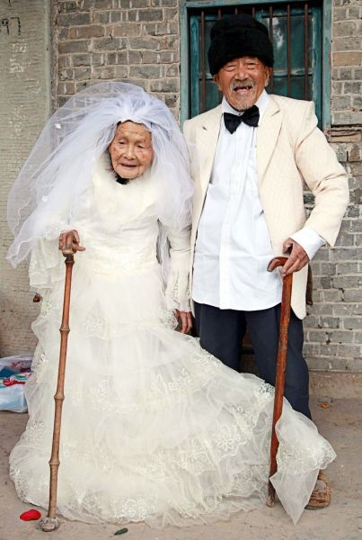 How cute is that! They are from China, 101 and 103 years old. They got married 80 years ago... what a pic!!!