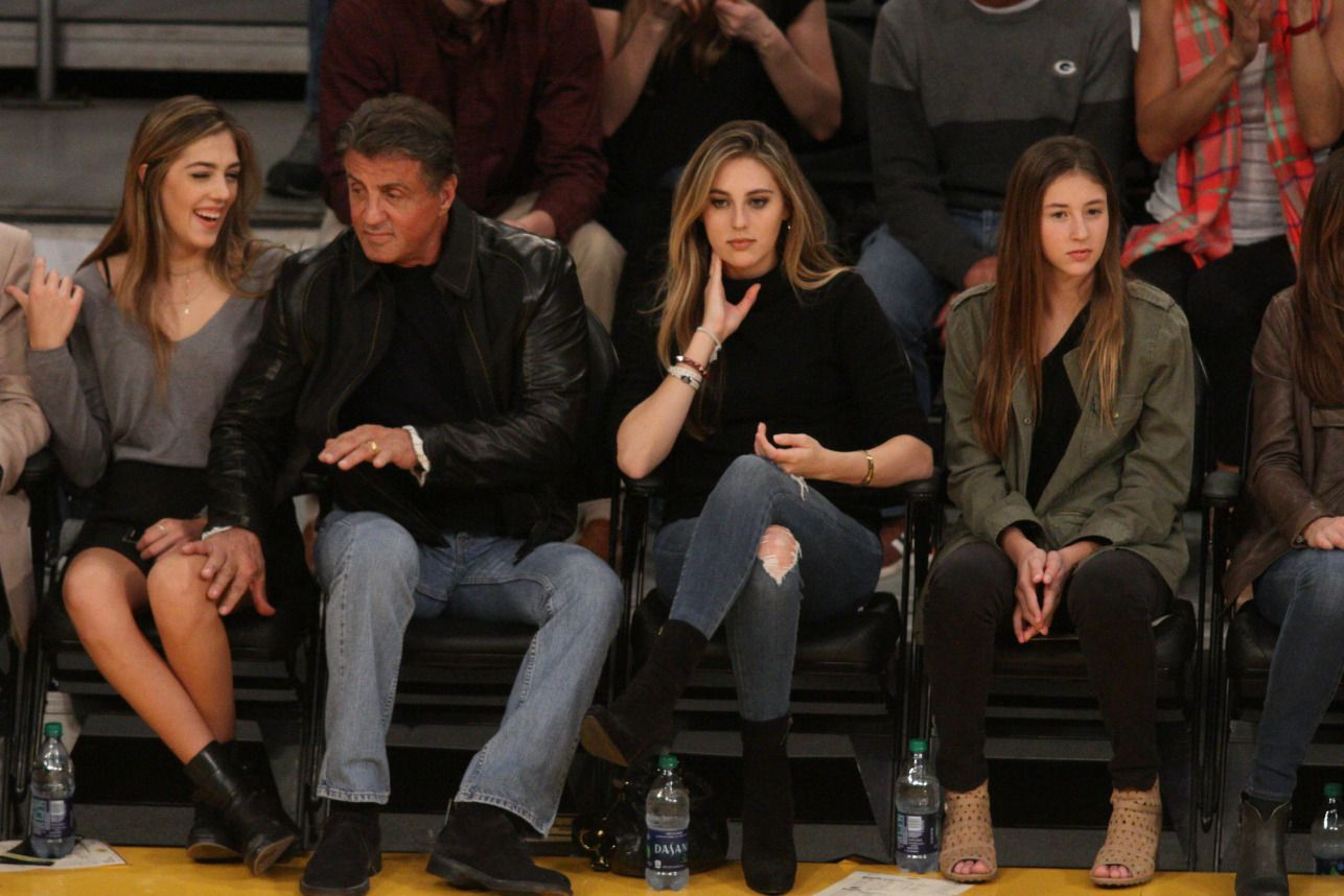 Sylvester Stallone and his daughters watch the Los Angeles Lakers on Thursday.
