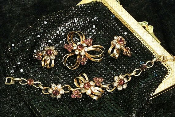 Hey, I found this really awesome Etsy listing at https://www.etsy.com/listing/244451075/mid-century-parure-brooch-bracelet
