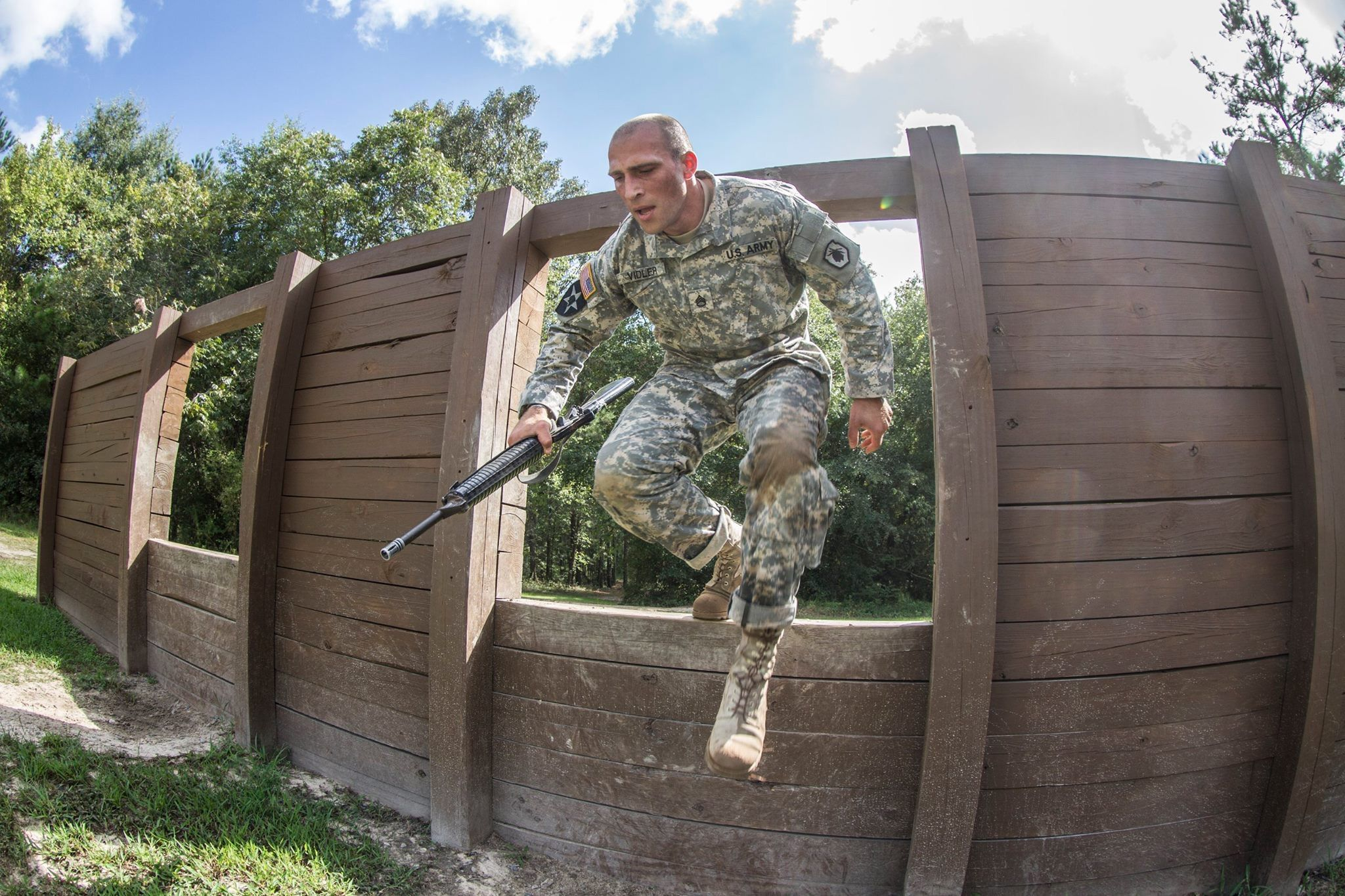 A U.S. Army Reserve negotiates a window obstacle in the Fit to Win obstacle course during the U.S. Army Training and Doctrine Command Drill Sergeant of Year competition at Fort Jackson, S.C., Sep 9 , 2015. #USArmy photo by Sgt. 1st Class Brian Hamilton