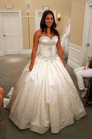 9cc5df232 White and Gold Wedding. Sweetheart Corset Ballgown Dress. A dramatic satin  ball gown has a crystal-encrusted bodice.