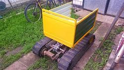 Tracked Mini Dumper by Vyacheslav.Nevolya -- Homemade tracked mini dumper constructed from a surplus motorcycle gearbox, a small engine, tubing, surplus truck tires, and sheetmetal. http://www.homemadetools.net/homemade-tracked-mini-dumper
