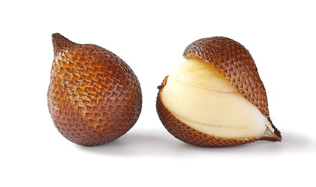 Salak:  Native to Indonesia and Malaysia, salak—also known as snake fruit or snakeskin fruit—is the shape and size of a ripe fig but with a pointed tip and brown scaly skin. It's prepared by breaking off the tip and peeling back the skin to reveal three yellowish-white lobes and a dark brown seed. It has a crisp texture and sweet flavour.