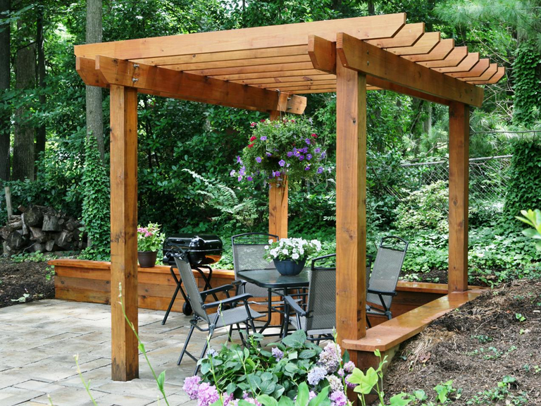 Picture of a pergola with a table and chairs.