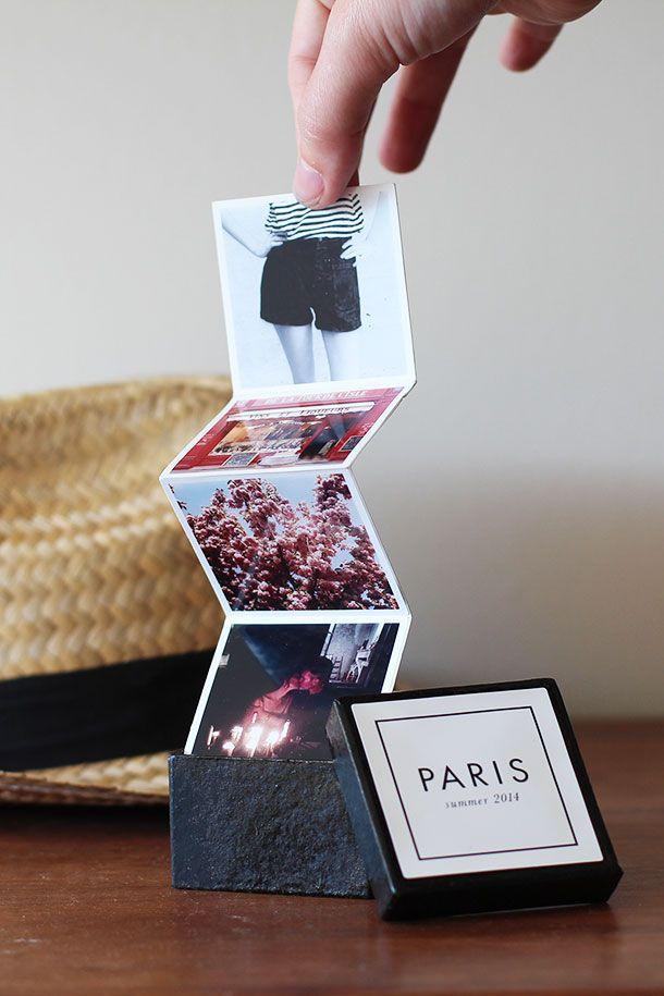 Ein kleines Fotoalbum in der Box als Erinnerung an eine gemeinsame Reise.