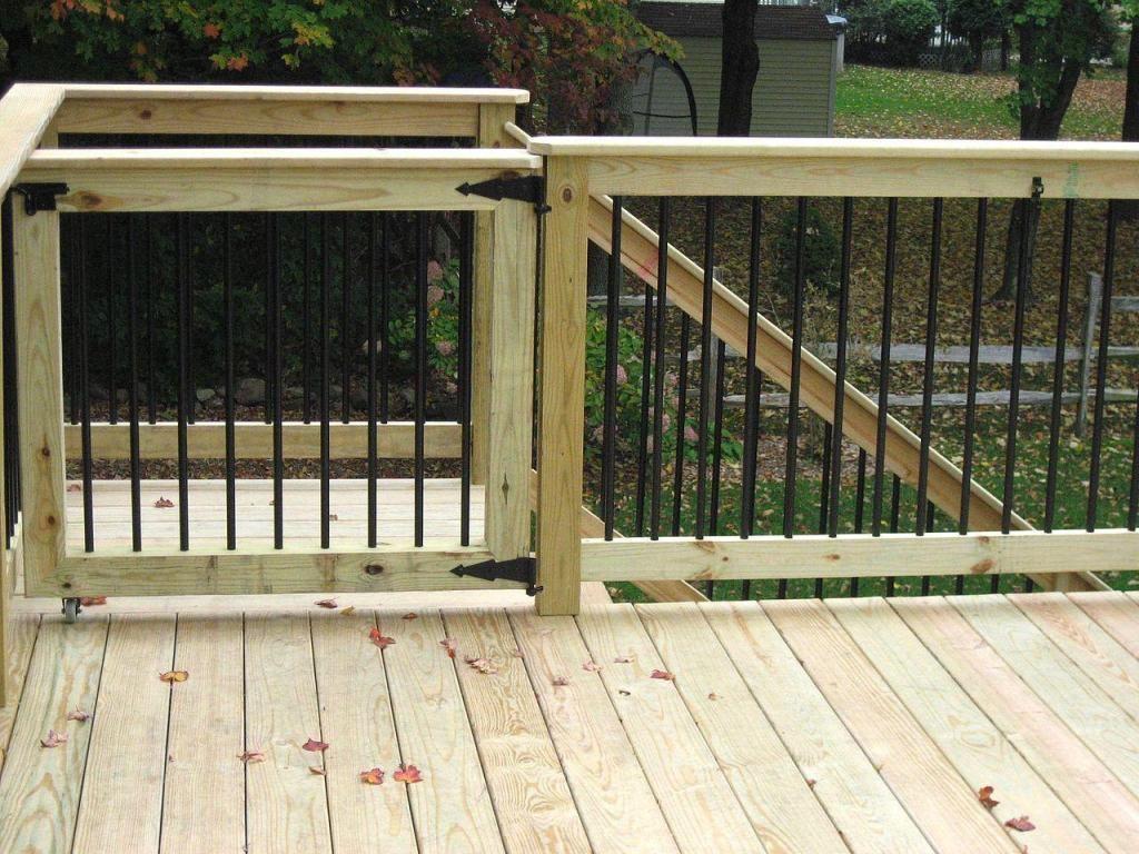 Vinyl deck railing 1024 768 deck build for Garden decking handrails