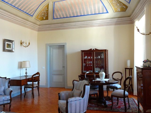 Tastefully furnished with the environment of the palazzo in mind is a the lounge area of one of the apartments. www.palazzomorichelli.it