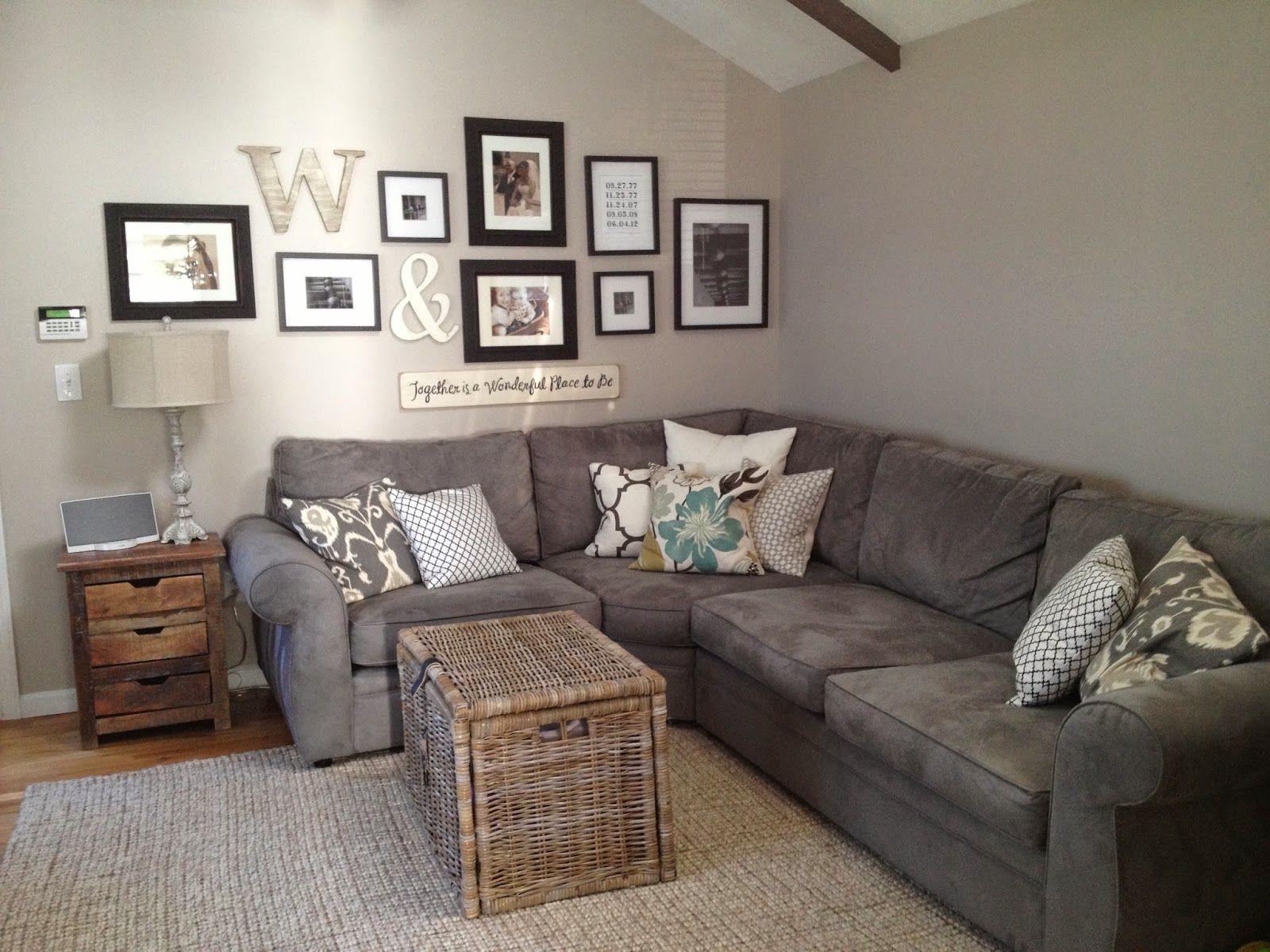 A Friendly Cozy Corner Including Couch, Gallery Wall And Decor