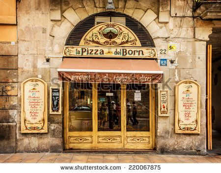 BARCELONA, CATALONIA/SPAIN - AUGUST 19: Old building facade and restaurant entrance with beautiful handmade signboards. August 19, 2014 in Barcelona, Spain. - stock photo