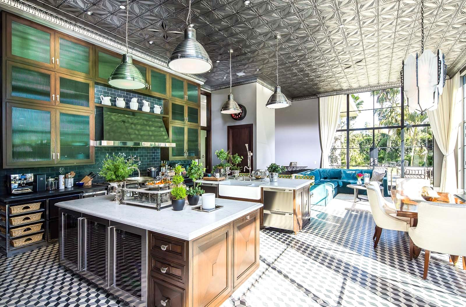 The ceiling in this room is amazing build gothic haunted house a huge gourmet kitchen has pressed tin ceilings cement tile floors in a graphic pattern large pendant lights a breakfast nook and a sitting area dailygadgetfo Image collections