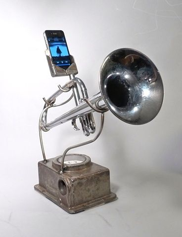 """The Revival"" by Christopher Locke, 2011 //  Brass, Steel, Stainless Steel  The ""Revival"" is an Analog Tele-Phonographer made from a nickel-plated horn and part of an old gas meter. The dock fits iPhone 4 and iPhone 4s, and is removable / replaceable for upgrade."