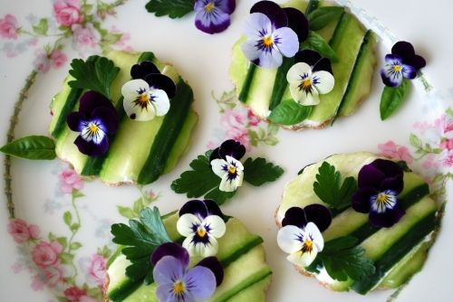 Open Face Cucumber Sandwiches decorated with violas, parsley & basil