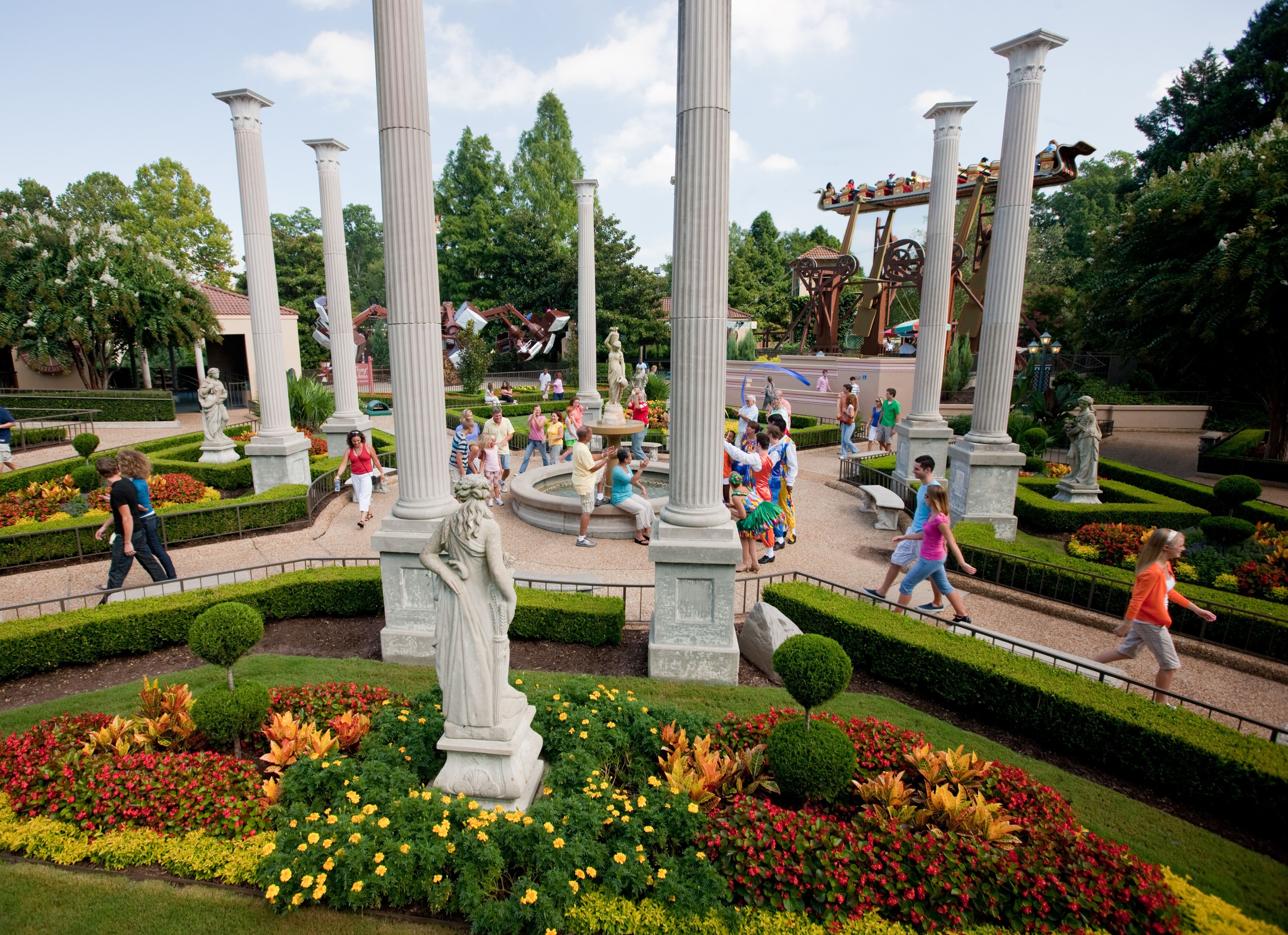 Italy Beautiful Street Side Statues Fountains And Lush Gardens Enhance The Italian Ambiance Of