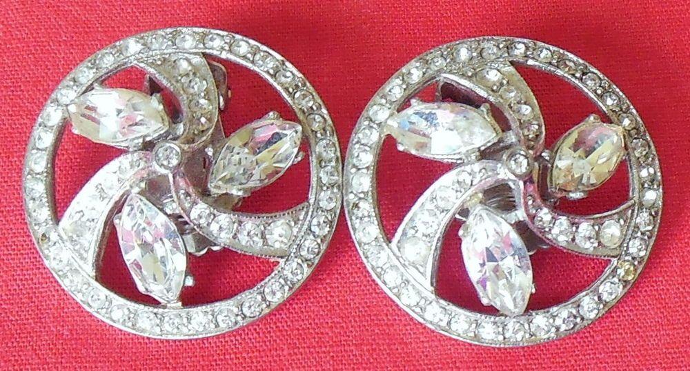 Silver-tone Clear Rhinestone Pinwheel Clip On Earrings Marked J Weisner/Astra