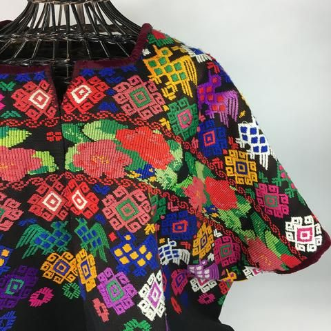 These are gorgeous huipiles, or over blouses, woven and worn by a Mayan woman in Guatemala. This one is a multi-color design on black. The colors combine beautifully. It's not fitted so it is perfect for wearing with skinny jeans or with a belt over a full skirt. These are woven