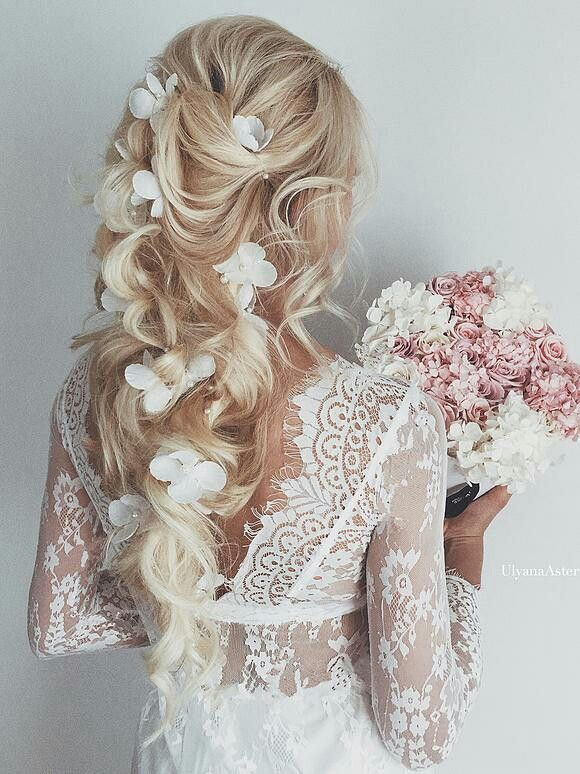 Blonde Wedding Hairstyle With White Flower Accessories And Soft