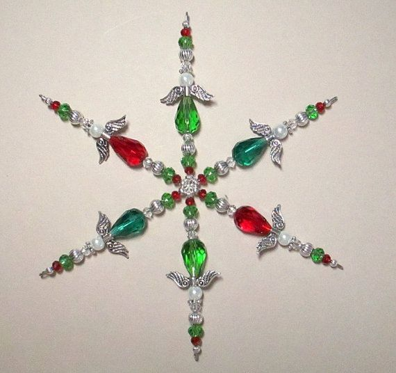 Beaded Snowflake ~ Christmas Ornament ~ Angel Ornament ~ Green & Red Ornament ~ Memorial Ornament ~ Snowflake Ornament ~ Guardian Angel BEADED SNOWFLAKE ORNAMENT This beautiful beaded snowflake ornament ~ guardian angel ornament is handcrafted using light siam, grass green and emerald faceted crystal beads, white glass pearls and silver plated angel wings, halo and accent beads. Comes with a red satin ribbon for hanging and cotton filled kraft box for gift giving and storage. Beautiful ...