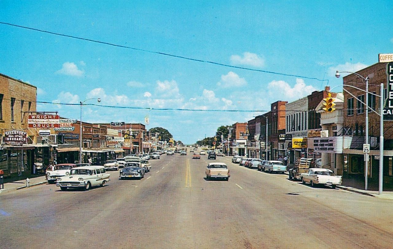 Route 66, the main drag in Weatherford, Oklahoma, as seen in this probable postcard view circa 1959 from AmeriCar the Beautiful.
