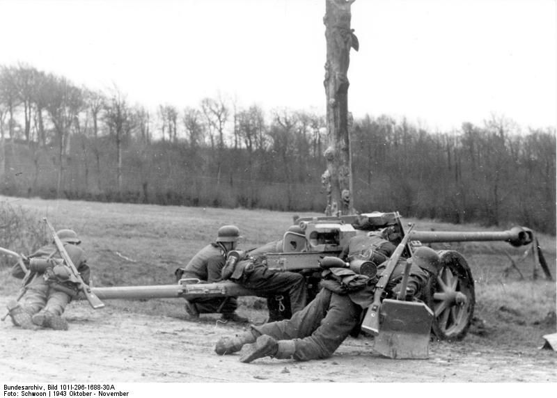 German gunners manning a Panzerabwehrkanone 7,5cm Pak 40 ( anti-tank cannon). North France October 1943
