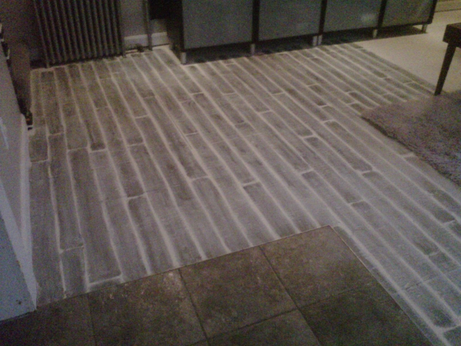 Faux gray woodplank painted subfloor this is effortless