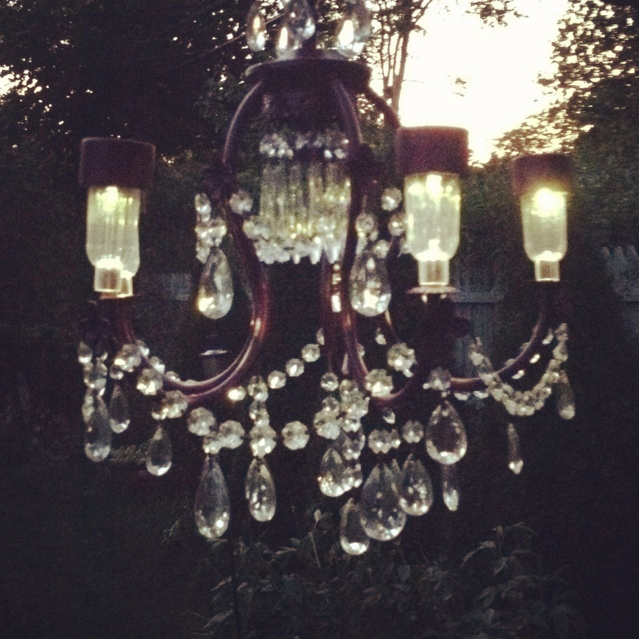 Every night before i go to bedi look outside at the solar lit the solar chandelier lit up at night chandelier created by valerie of deco rust arubaitofo Choice Image