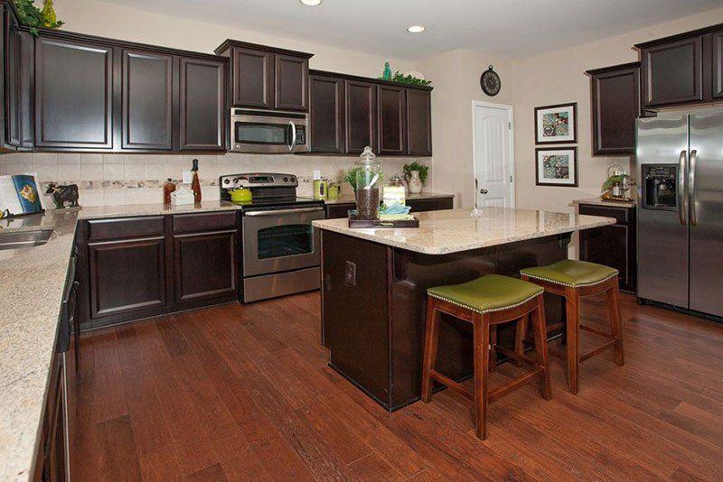Dark brown cabinets with river white granite   Kitchen ...