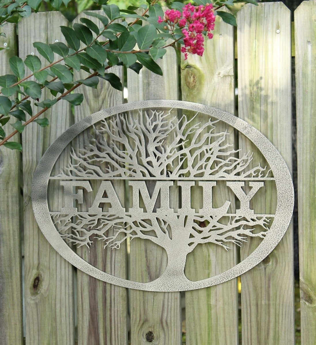 Family tree wall art mounted outside on a wooden fence metal tree