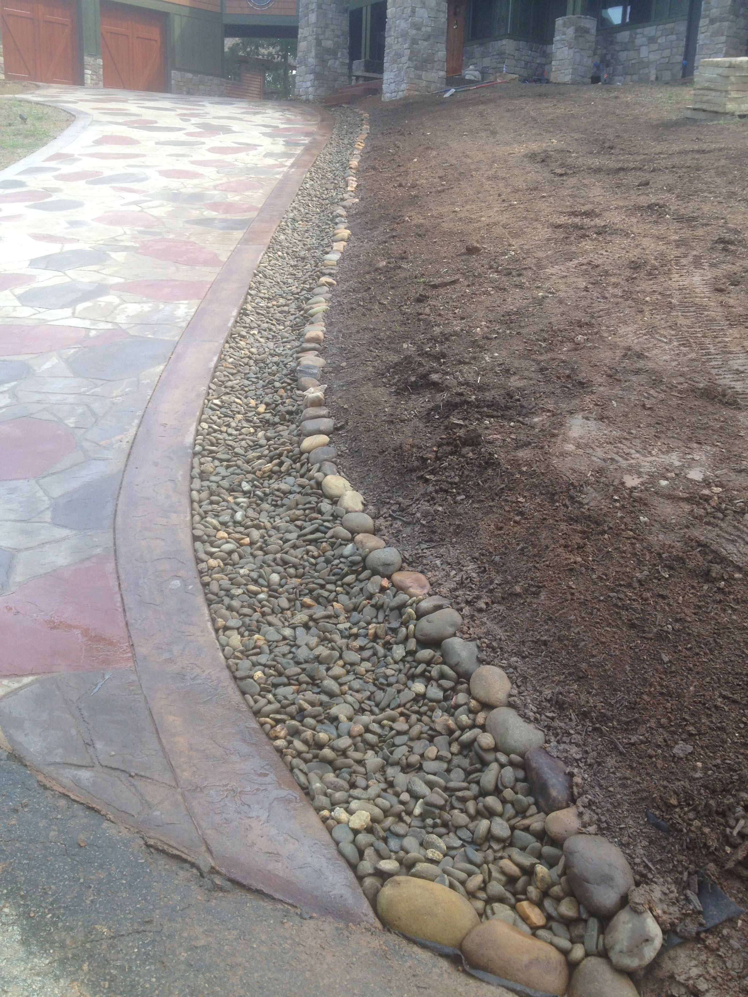 Handling Rainwater Runoff From A Concrete Driveway With Beautiful