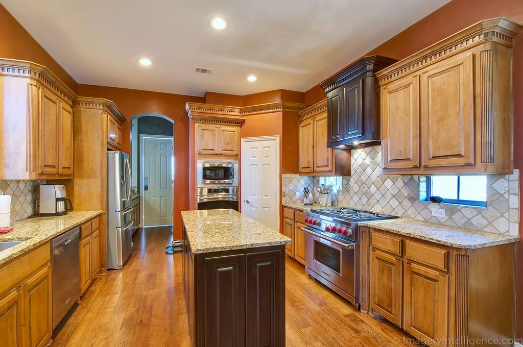 Molding on kitchen cabinets are sure to add depth and ...