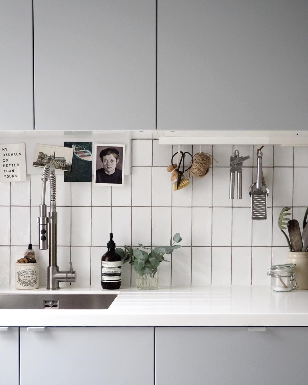 Simple grey kitchen - IKEA kitchen - white metro tiles - utilitarian ...